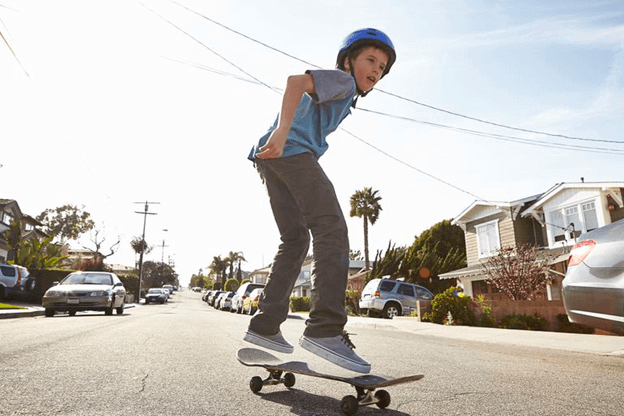 Kid skating on road